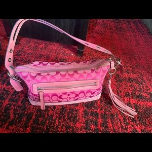 Coach East West purse with tassel
